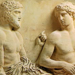 bas relief of two gods