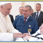 Pope Francis greeting man on guerney2